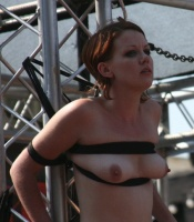 Figure 10. Woman tied to a scaffold with involvement of her breasts